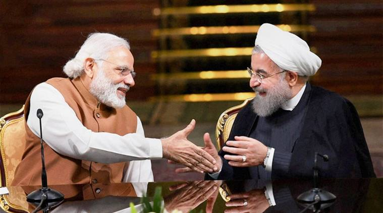 Tehran: Prime Minister Narendra Modi shakes hands with Iranian President Hassan Rouhan during a joint press conference after their meeting at the Saadabad Palace in Tehran, Iran, Monday. PTI Photo by Shahbaz Khan(PTI5_23_2016_000046B)